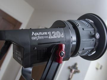 Rent: Aputure Light storm 120D +Fresnel Lens, Barn Door, and Gels