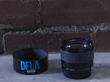 Rent: Hasselblad HC 100mm f/2.2 Lens - VII/Orange Available