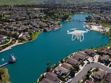 Rent: Drone Service / DJI Phantom 4  With Pilot Operator (FAA107)