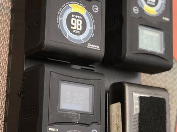 4 Gold Mount Batteries with a Charger