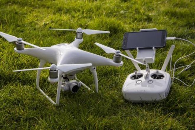 DJI Phantom 4 (4K) Drone & Operator
