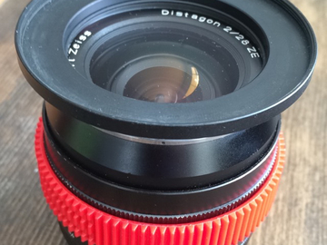 Rent: Zeiss 28mm ZE F2 Lens Canon EF Mount w/ Step Up and Gear