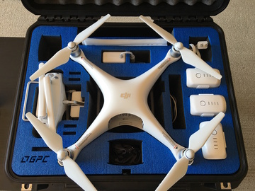 Rent: DJI Phantom 4 Drone w/ 3 Batteries, Filters, and Hard Case