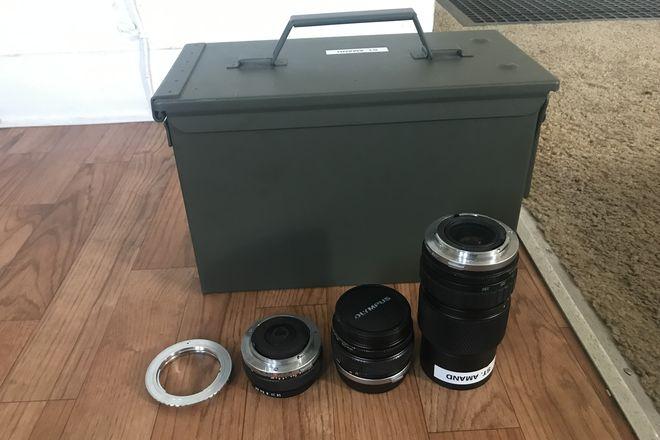 EF-mount Zuiko 28mm, 50mm, and 75-150mm