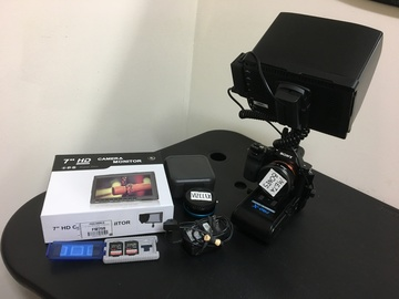 Rent: A7s w/ cards, power, adapters, monitor, & camera bag.