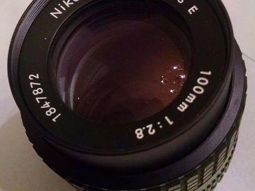 Rent: Nikon 100mm F/2.8 Series E Manual Lens (w/EF Adapter)