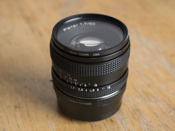 Rent: Zeiss C/Y 50mm Planar f1.7 (w/UV Filter + m43 Adapter)