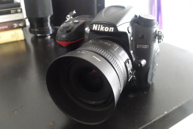 Nikon D7000 2 lenses  and 3 batteries