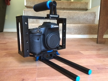 7D camera with Video cage and rails EF mount