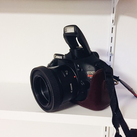 Canon t3i with 50mm lens in leather case